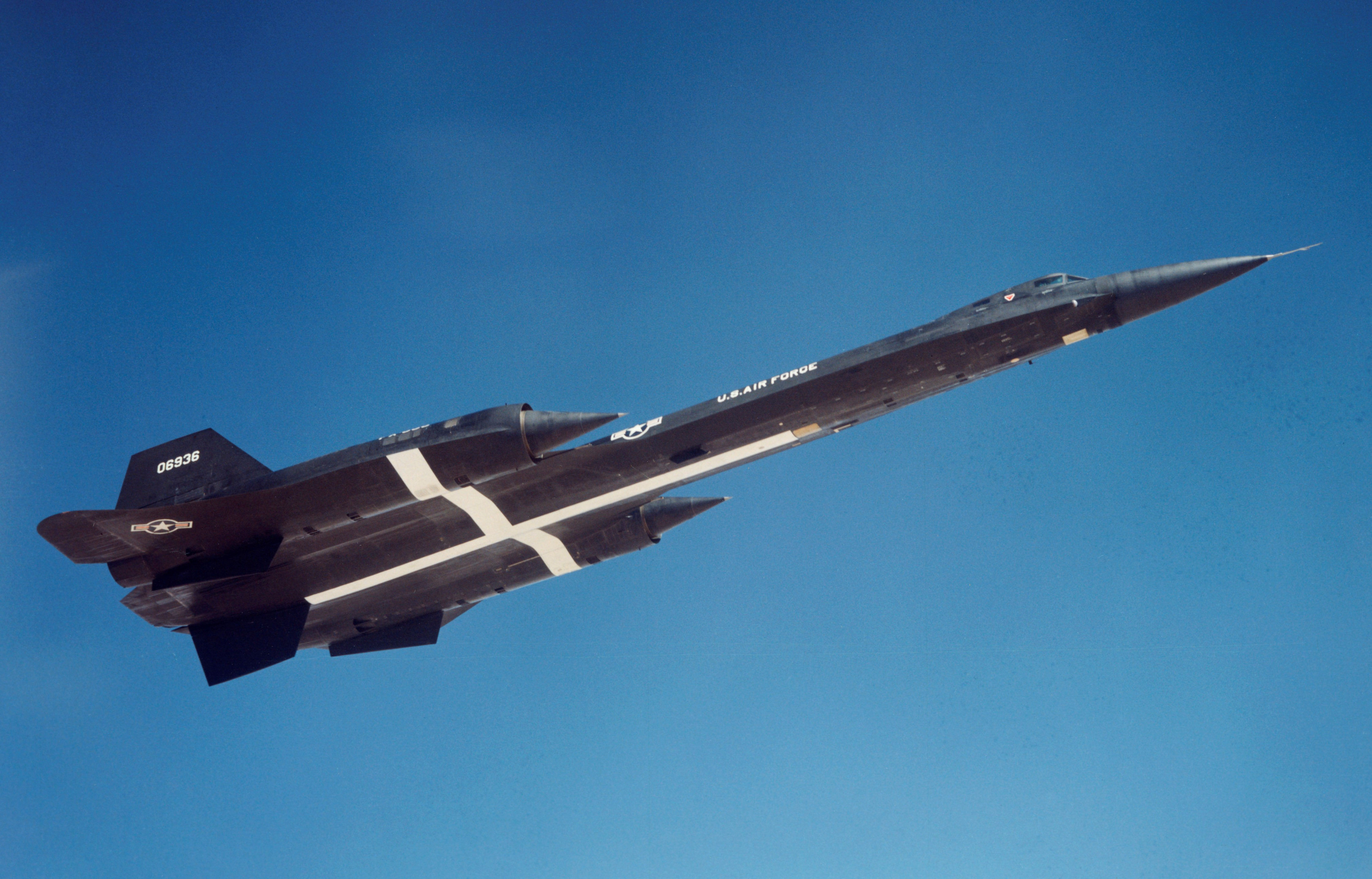 The third YF-12a departs Edwards AFB in 1965. The white cross painted on the lower fuselage assisted in tracking the aircraft during the speed and altitude record flights. (Lockheed photo)